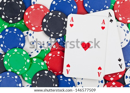 Pair of Aces on casino chips - gambling or poker concept