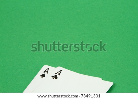 Pair of Aces - Poker Hand on Green Felt Background - stock photo