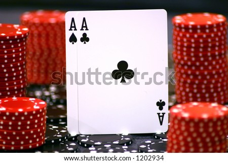 Pair of aces surrounded by red and black chips, selective focus - stock photo