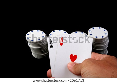 pair of aces with white chips - stock photo
