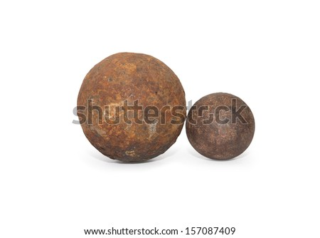 Pair of ancient rusty cannon-balls on white background. Clipping path is included - stock photo