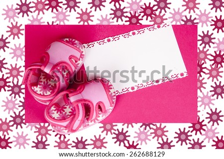 pair of baby girl shoes with white place for your text in floral frame - stock photo