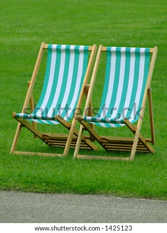 Pair of beach chairs on grass