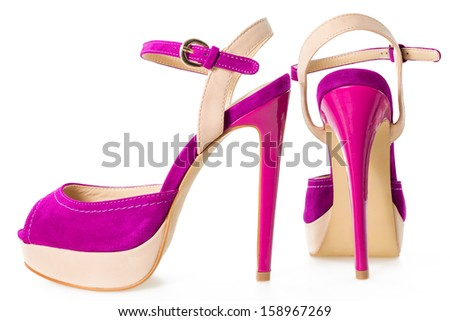Pair of beautiful pink and beige  high hilled shoes, isolated on white background - stock photo
