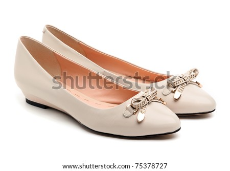 Pair of beige female shoes over white background - stock photo
