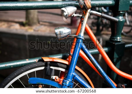 Pair of bicycles rested against each other in Amsterdam, the Netherlands - stock photo
