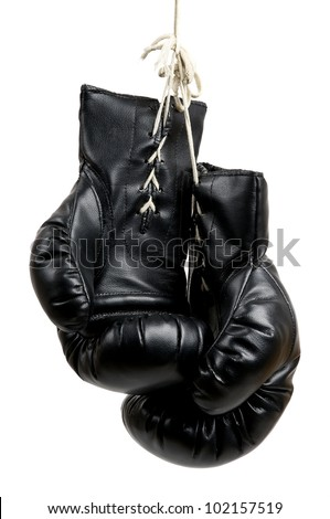 pair of black boxing gloves isolated on a white background - stock photo