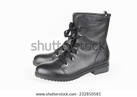 pair of black female boots isolated on white
