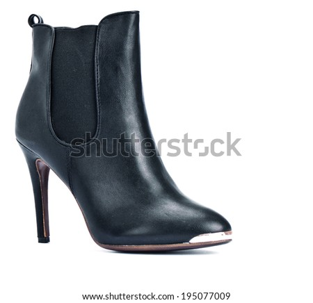 Pair of black female boots isolated on white background