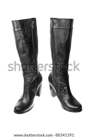Pair of black female boots over white background