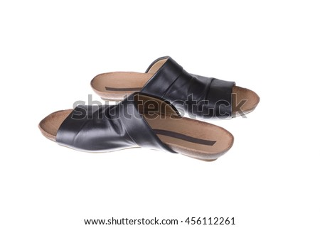 pair of black females slippers over white - stock photo