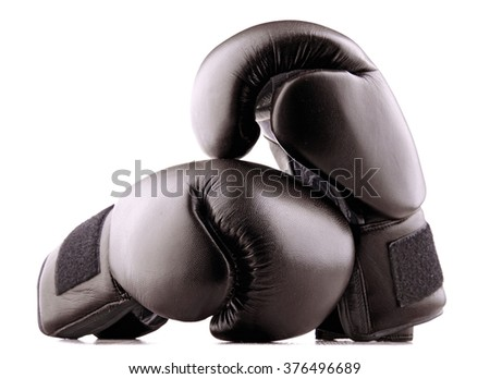 Pair of black leather boxing gloves isolated on white background - stock photo