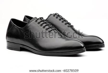 Pair of black male classic shoes on white background - stock photo