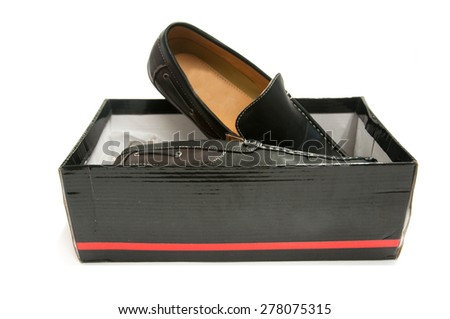 Pair of black male shoes in box isolated on white - stock photo