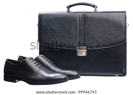 Pair of black men shoes and briefcase isolated over white - stock photo