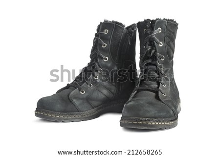 Pair of black nubuck leather hiking boots on white background