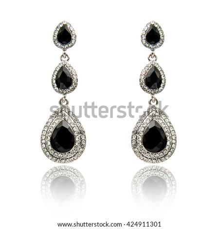 Pair of black spinel diamond earrings isolated on white
