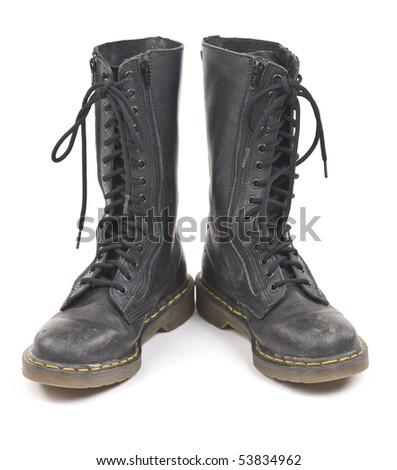 Pair of black worn old combat boots. Isolated on white background. - stock photo
