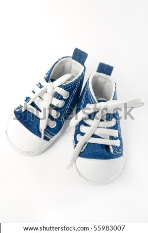 pair of blue and white sneakers on white