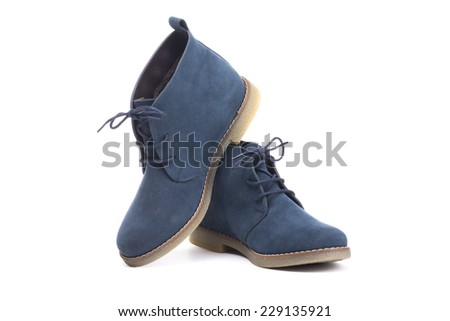 pair of blue boots on white background