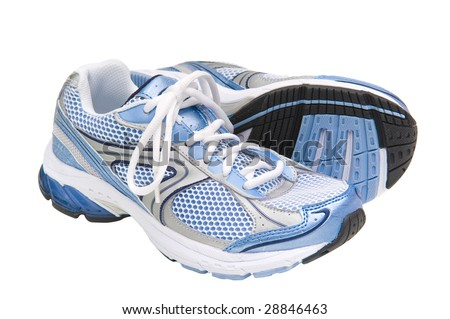 Pair of blue running shoes isolated on a white background with clipping path. - stock photo