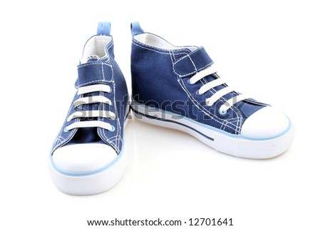 pair of blue sneakers isolated on white