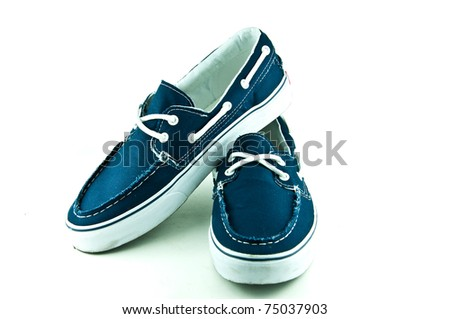 Pair of blue sneakers isolated on white background - stock photo