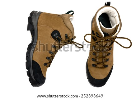 pair of boots isolated on the white background - stock photo