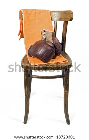 Pair of Boxing Gloves on chair - stock photo