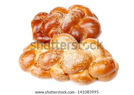 Pair of braided shabbat challah isolated on white background - stock photo