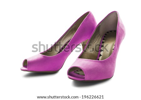 Pair of bright pink textile high heeled shoes on white background