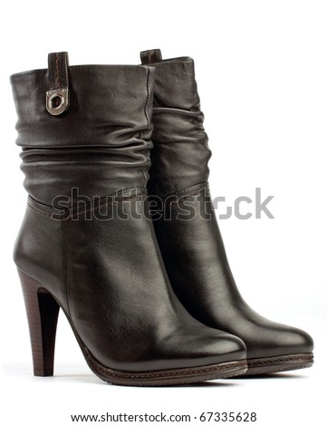 Pair of brown female boots on white - stock photo