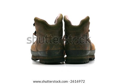 Pair of brown leather hiking boots, rear view on white background. Not retouched. - stock photo