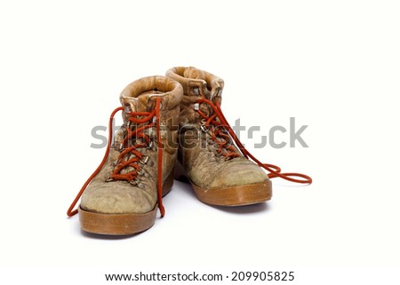 Pair of brown leather work boots on white - stock photo
