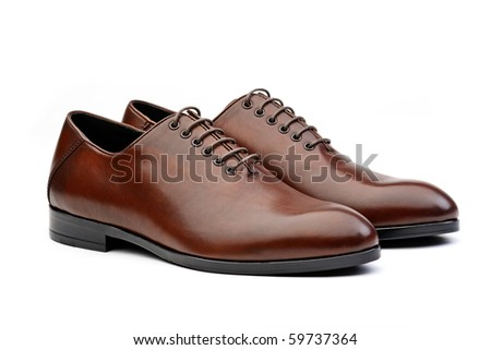 Pair of brown male classic shoes isolated on white background - stock photo