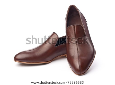 Pair of brown male shoes over white background - stock photo