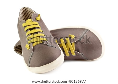 pair of brown men sneakers isolated on white background - stock photo