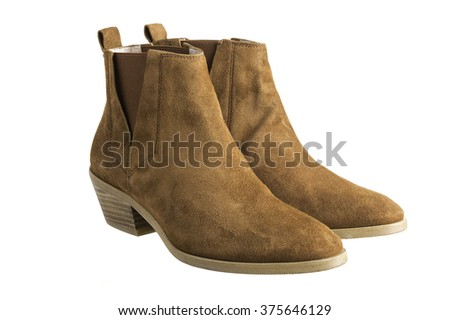 Pair of brown suede women boots on white