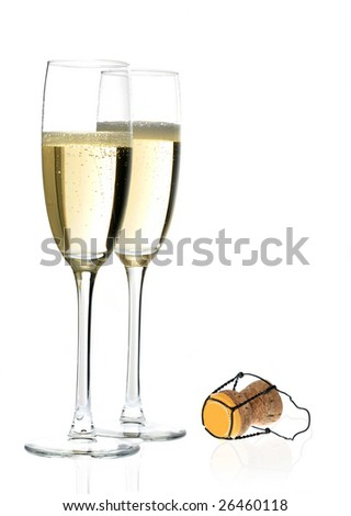 Pair of champagne flutes and cork - stock photo