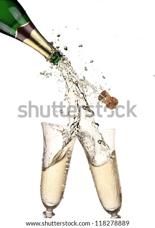 Pair of champagne flutes making a Champagne splash - stock photo