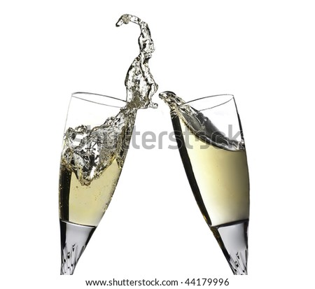 Pair of champagne flutes making a toast. Champagne splash - stock photo