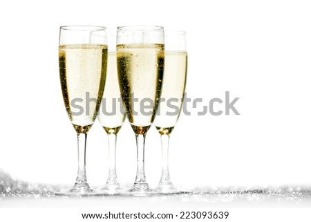 Pair of champagne flutes on shiny glitter background - stock photo