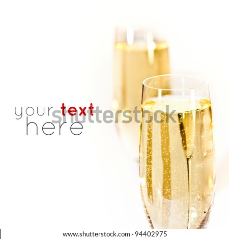 Pair of champagne flutes. Sample text - stock photo