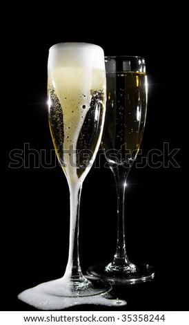 Pair of champagne glasses isolated on black