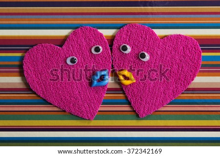 Pair of cheerful hearts. - stock photo