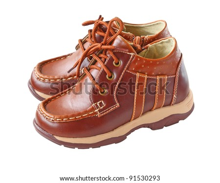 Pair of child's bootls it is isolated on a white background - stock photo