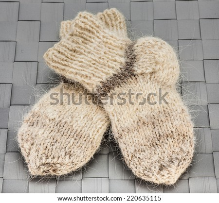pair of child wool warm knitted socks - stock photo