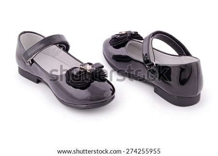 Pair of children's black patent leather shoes. Clipping path included.  - stock photo