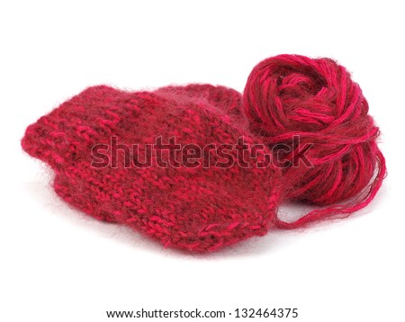 Pair of children's mittens and wool ball on a white background - stock photo