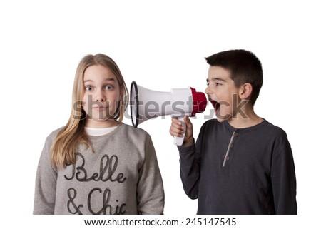 pair of children with megaphone - stock photo